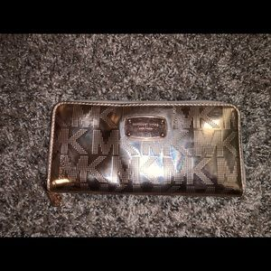 Michael Kors Rose Gold Wallet in good condition